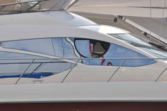 Driving room window of yacht. Window and reflect image of yacht driving room, shown as holiday and marine sport Stock Images