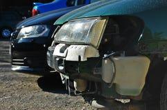 Broken car vs. unbroken car stock image