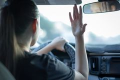 Angry woman driver. Rushing to work. Traffic jam. Busy life. Teenager reckless driving. Driving safety awareness, Campaign against road rage. Anger and Royalty Free Stock Images