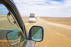 Driving through the Sahara Desert. In Morocco Stock Photos