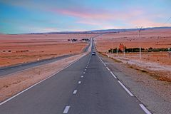 Driving through the Sahara Desert in Morocco Africa. At sunset Stock Photos