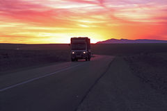 Driving through the Sahara Desert in Morocco. At sunset Royalty Free Stock Photography
