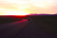 Driving through the Sahara Desert in Morocco. At sunset Royalty Free Stock Images