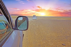 Driving through the Sahara Desert in Morocco at sunset. Driving through the Sahara Desert in Morocco Africa at sunset Stock Photo