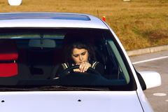 Driving school. Young girl is practise car driving at a driving school polygon Stock Photography