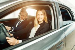 Driving School - woman steer car with steering wheel, maybe she has driving test Royalty Free Stock Images