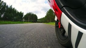 Driving scooter - Operator low Point of View. Man Riding a motorcycle in the for stock footage