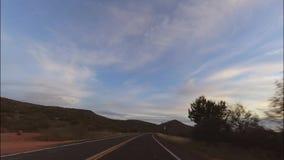 Driving from Sedona, Arizona to Phoenix. Driving from Sedona, Arizona towards Phoenix at Sunset hyper lapse stock video footage