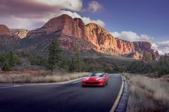 Driving through Sedona red rock mountains. stock photo