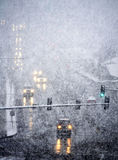 Driving in Severe Snow Storm. Snowy winter road with cars driving on roadway in snow storm Royalty Free Stock Images