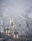 Driving in Severe Snow Storm. Snowy winter road with cars driving on roadway in snow storm Royalty Free Stock Photos