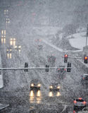 Driving in Severe Snow Storm. Snowy winter road with cars driving on roadway in snow storm Stock Image