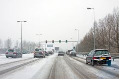 Driving in a severe snowstorm in Amsterdam in the Netherlands Stock Photo