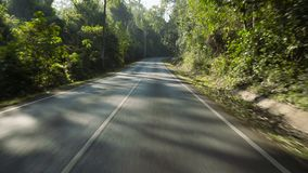 Driving shot on an empty road. In Khao Yai National Park stock video footage