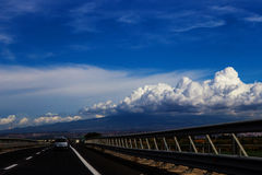 Driving the Sicilian Highway. Mount Etna is in the clouds on the right. Sicily, Italy royalty free stock photos