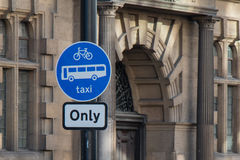 Driving Sign with a Building. Driving Sign: Bicycle, bus, and taxi only, with a building royalty free stock photography