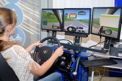 Driving through a simulator. Woman royalty free stock images