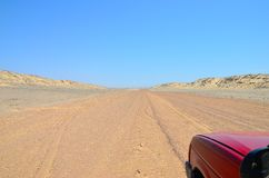 Driving the Skeleton Coast, Namibia. A sandy road along the Skeleton Coast, Namibia stock image