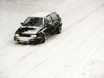 Driving in the snow 2. Car in snowstorm Stock Images