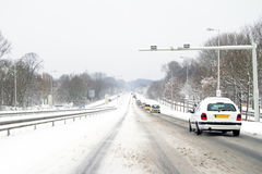 Driving in the snow in the Netherlands Stock Photo