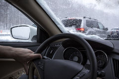 Driving in snow Stock Photo