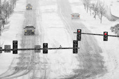 Driving on Snow and Snowy Roads in Winter Blizzard. Driving on snow and snowy roads in winter traffic lights blizzard stock photography