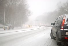 Driving in a snow storm. Traffic line under snow storm Stock Photography