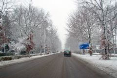 Driving in the snow in winter in the Netherlands. Driving in the snow in winter in the countrye from the Netherlands Stock Photo