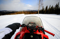 Driving snowmobile Royalty Free Stock Images