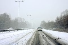 Driving during a snowstorm Stock Images