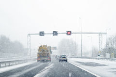Driving during a snowstorm in Amsterdam the Netherlands Stock Photo