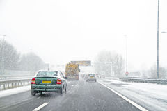 Driving during a snowstorm in Amsterdam the Netherlands Royalty Free Stock Photos