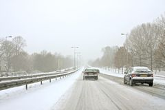 Driving during a snowstorm in the Netherlands. Driving during a snowstorm in the winter in the Netherlands Stock Photo