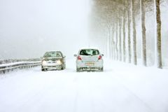 Driving during a snowstorm in the winter Royalty Free Stock Images