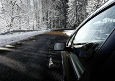 Driving on the snowy, winter road Stock Images