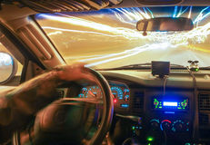 Driving at speed of light. On city streets at night stock photography