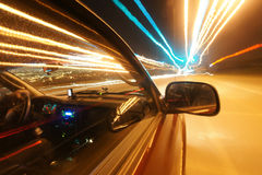Driving at speed of light. On city streets at night royalty free stock images