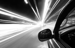 Driving at speed of light. On city streets at night royalty free stock image