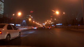 Driving street at night of Beijing, China. Driving along famous East Changan Avenue at night in Beijing, China stock footage