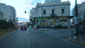 Driving on the streets at Athens, twilight, the road to the Port, view through the front windshield. stock footage