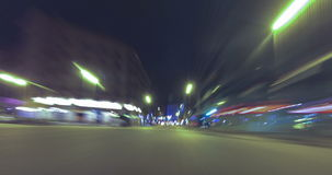 Driving through the streets of Barcelona with Christmas lights.Time Lapse - Trail effect -  4K. (01). Driving after dark through the streets of Barcelona with stock video footage