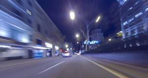 Driving through the streets of Barcelona with Christmas lights.Time Lapse - Trail effect - 4K.(03) stock footage