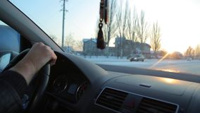 Driving at sunrise. Hand on steering wheel close up. stock video footage