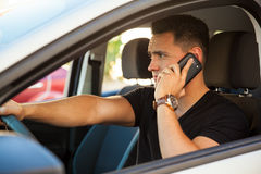 Driving and talking on the phone Stock Image