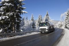 Driving a tanker. winter landscape.  Stock Image