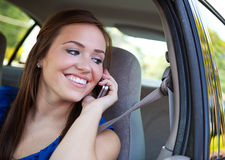 Driving: Teen Female on Phone in Car Royalty Free Stock Image