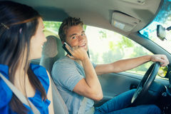 Driving: Teen Male on the Phone While Driving. Series with two teens driving in a car.  Includes lots of images with texting and looking at cel phones while in Stock Photography