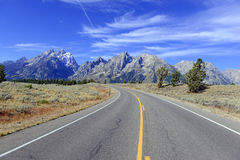 Driving in the Teton Range, Rocky Mountains, Wyoming, USA Royalty Free Stock Photo