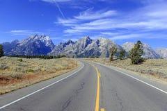Driving in the Teton Range, Rocky Mountains, Wyoming, USA Royalty Free Stock Photo