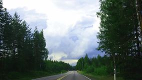 Driving time lapse on a country road through the forest from Kotka to Lappeenranta. Southeast Finland stock video footage